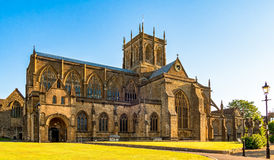 Sherborne Abbey at Sunrise. The beautiful ancient architecture of Sherborne Abbey, in Dorset UK Royalty Free Stock Images
