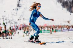 Sheregesh, Kemerovo region, Russia - April 13, 2019: Grelka Fest ski and snowboard riders in bikini