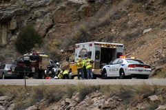 First response. Sheriff, ambulance, and first response truck attend to and injured person on the side of the road in the mountains of colorado stock photography
