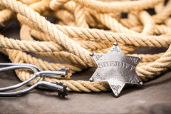 Sheriff badge, spurs and lasso. Royalty Free Stock Image