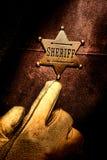 Sheriff del oeste americano Badge Finger Pointing de la leyenda Foto de archivo libre de regalías