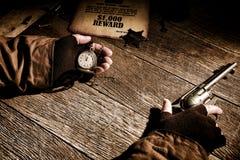 Sheriff del oeste americano Keeping Time de la leyenda en el reloj Imágenes de archivo libres de regalías