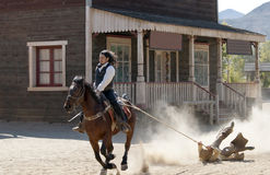 Sheriff drags a bandit. By rope at Mini Hollywood, Tabernas, Almeria Province, Andalusia, Spain stock image