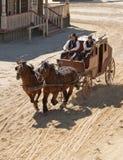 Sheriff en zijn Afgevaardigde op stagecoach Stock Afbeelding
