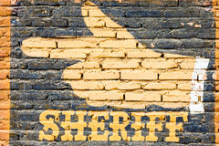 Sheriff. Graffiti on an old brick wall. Concept for security royalty free stock photography