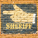 Sheriff. Graffiti on an old brick wall. Concept for security royalty free stock photo