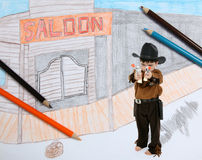 Sheriff in Imaginary Town. Four year old boy dressed as sheriff guarding imaginary old west town stock images