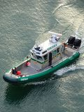 Sheriff Patrol Boat. A Sheriffs boat patrols the harbor for any specious activity that might be trying to get through the waters stock photos