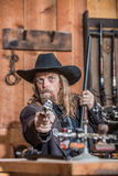 Sheriff Points Gun. Stern Sheriff Points Loaded Gun at You royalty free stock photography