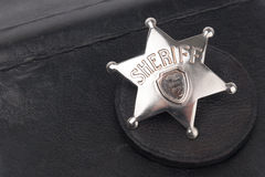 Sheriff's badge on dark Royalty Free Stock Photos