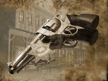 Sheriff's gun. Close view to a sheriff's star and his chromed gun. In the background of the gun, we can see the sheriff's town. Image on a grunge backgound to royalty free illustration