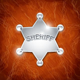 Sheriff's metallic badge as star Stock Image