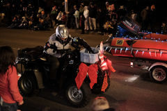 Sheriff's search and rescue deputy rides ATV in holiday parade. Corvallis, OR, Nov 28, 2015: Sheriff's deputy rides an all terrain vehicle in the holiday parade Royalty Free Stock Photo