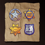Sheriff stars on old paper background. Stock Photos
