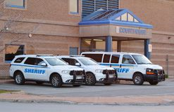 Sheriff Vehicles. PICTOU, CANADA - MAY 14, 2018: Nova Scotia Sheriff vehicles outside the Pictou Courthouse. Sheriffs currently serve all counties in Nova Scotia stock photos