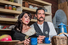 Sheriff and Woman Pose Inside House Royalty Free Stock Photos