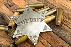 Sheriffemblem och kulskal arkivbilder