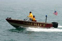 Sheriffs Boat On Patrol. A Small Sheriffs Boat patrols The Lake Stock Photo