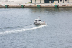 Sheriffs Boat Turning in Harbor Royalty Free Stock Photo