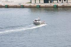Sheriffs Boat Turning in Harbor. Broward County harbor patrol boat in Fort Lauderdale Florida royalty free stock photo