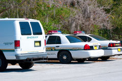 Sheriffs car and van - police car. Parking lot at sheriff's office stock photography