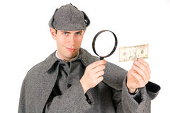 Sherlock: Überzeugter Detektiv Examines Ten Dollar Bill lizenzfreie stockbilder