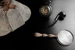 Sherlock Deerstalker Hat,  Clock, Magnifier And Smoking Pipe In. Sherlock Holmes Deerstalker Hat, Vintage Clock, Retro Magnifier And Smoking Pipe On The Black Royalty Free Stock Images