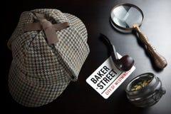 Sherlock Deerstalker Hat,  Clock, Magnifier And Smoking Pipe In. Sherlock Holmes Deerstalker Hat, Vintage Clock, Retro Magnifier And Smoking Pipe On The Black Stock Photography