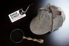 Sherlock Deerstalker Hat,  Clock, Magnifier And Smoking Pipe In. Sherlock Holmes Deerstalker Hat, Vintage Clock, Retro Magnifier And Smoking Pipe On The Black Stock Images