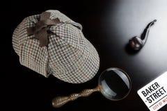 Sherlock Deerstalker Hat,  Clock, Magnifier And Smoking Pipe In. Sherlock Holmes Deerstalker Hat, Vintage Clock, Retro Magnifier And Smoking Pipe On The Black Royalty Free Stock Photo