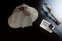 Sherlock Deerstalker Hat,  Clock, Magnifier And Smoking Pipe. Sherlock Holmes Deerstalker Hat, Vintage Clock, Retro Magnifier And Smoking Pipe On The Black Table Stock Photography