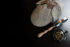 Sherlock Deerstalker Hat,  Vintage Clock And Magnifier On Black Royalty Free Stock Images