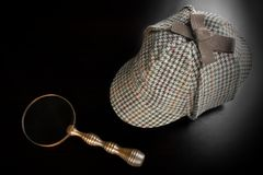 Sherlock Deerstalker Hat,   And Vintage  Magnifying Glass Royalty Free Stock Photos