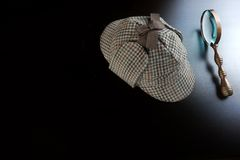 Sherlock Deerstalker Hat,   And Vintage  Magnifying Glass Royalty Free Stock Photography
