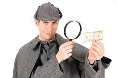 Sherlock: Detetive seguro Examines Ten Dollar Bill imagens de stock royalty free
