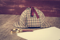 Sherlock Hat and magnifying glass Royalty Free Stock Photography