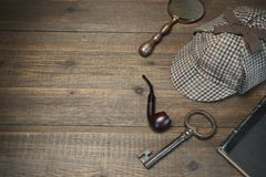 Sherlock Holmes Concept. Private Detective Tools On The Wood Tab royalty free stock photo