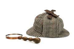 Sherlock Holmes Deerstalker Cap And Vintage Magnifying Glass Iso Royalty Free Stock Photos