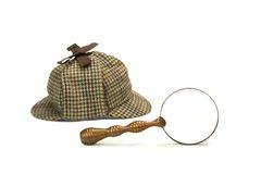 Sherlock Holmes Deerstalker Cap And Vintage Magnifying Glass Iso Stock Photo