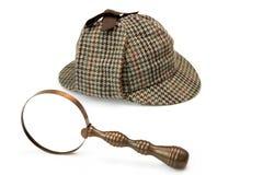 Sherlock Holmes Deerstalker Cap And Vintage Magnifying Glass Iso Royalty Free Stock Photos