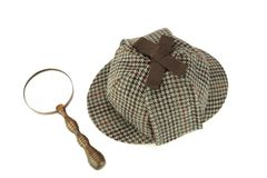 Sherlock Holmes Deerstalker Cap And Vintage Magnifying Glass Iso Royalty Free Stock Photography