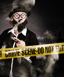 Sherlock Holmes detective at crime scene Stock Images