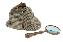 Sherlock Holmes Hat and Retro Magnifying Glass Royalty Free Stock Image