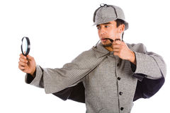 Sherlock holmes with magnifying glass Stock Photos