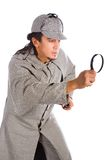 Sherlock holmes with magnifying glass Royalty Free Stock Image