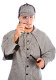 Sherlock holmes with magnifying glass Stock Photo