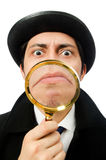 Sherlock Holmes with magnifying glass isolated on Stock Photography