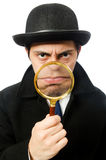 Sherlock Holmes with magnifying glass isolated on Royalty Free Stock Images