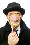 Sherlock Holmes with magnifying glass isolated on Stock Photo