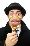 Sherlock Holmes with magnifying glass Royalty Free Stock Photography